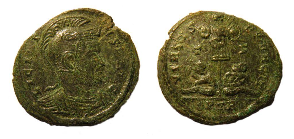 A nummus of Licinius II, VIRTVS EXERCITVS, reverse type depicting two prisoners seated under standard. Copyright: Trustees of the British Museum. License: Attribution License.