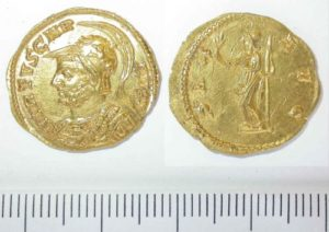 A gold coin called an aureus of the emperor Carausius