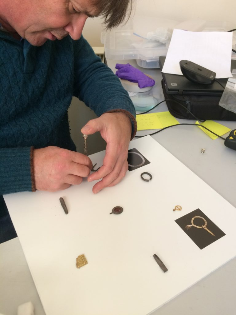 Jonathan Wallis, Head of Museum and Museum and Art Gallery Development at Derby Museums, mounting some of the Treasure objects.