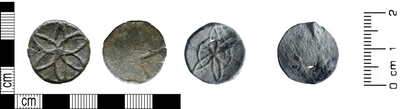 Image of the front and back of two lead alloy tokens arranged side by side.
