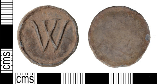 Image of the front and back of a circular token with a W shaped mark on it.