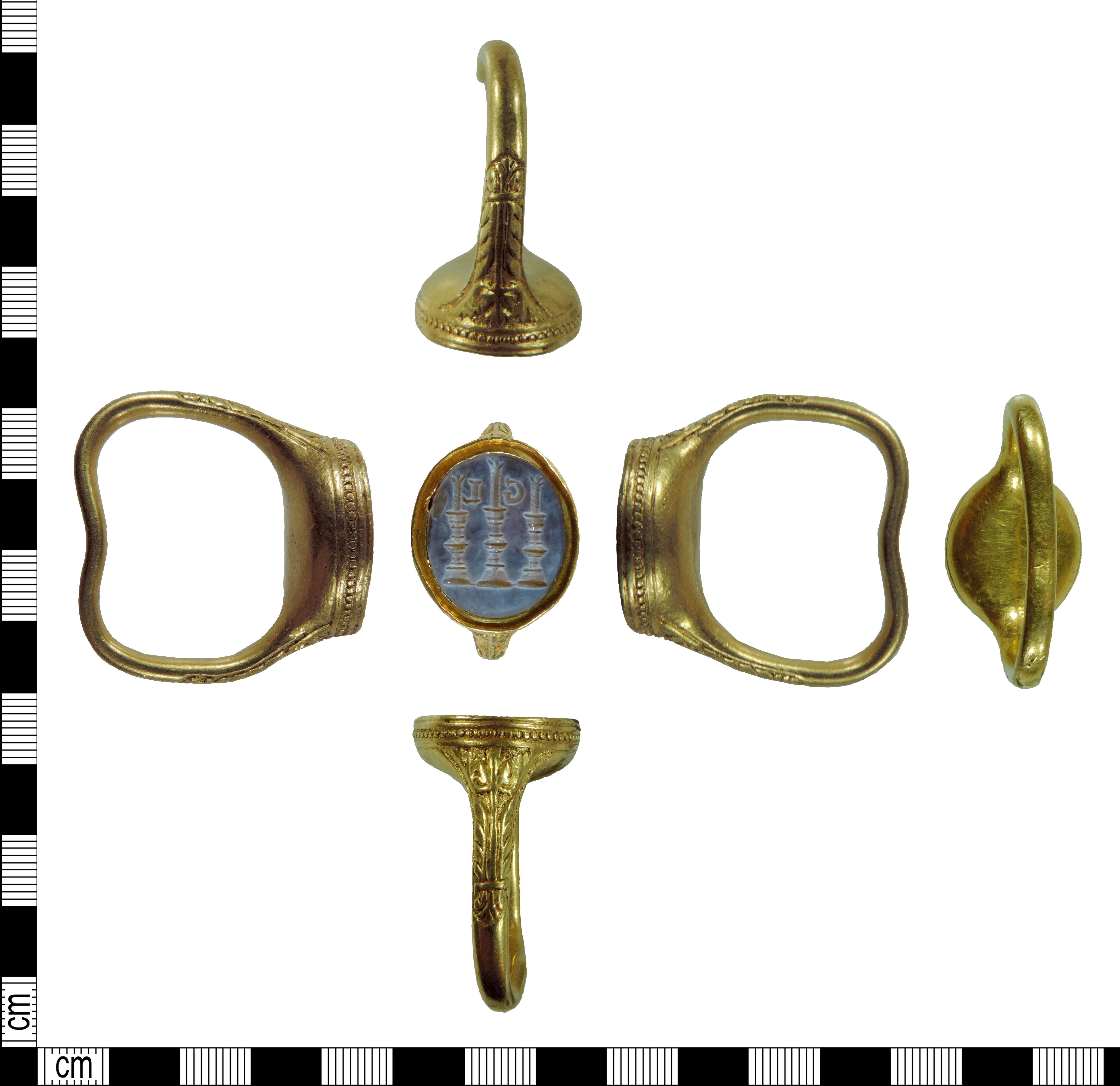 A Post medieval gold signet ring, with three candlesticks and two initials on the device.
