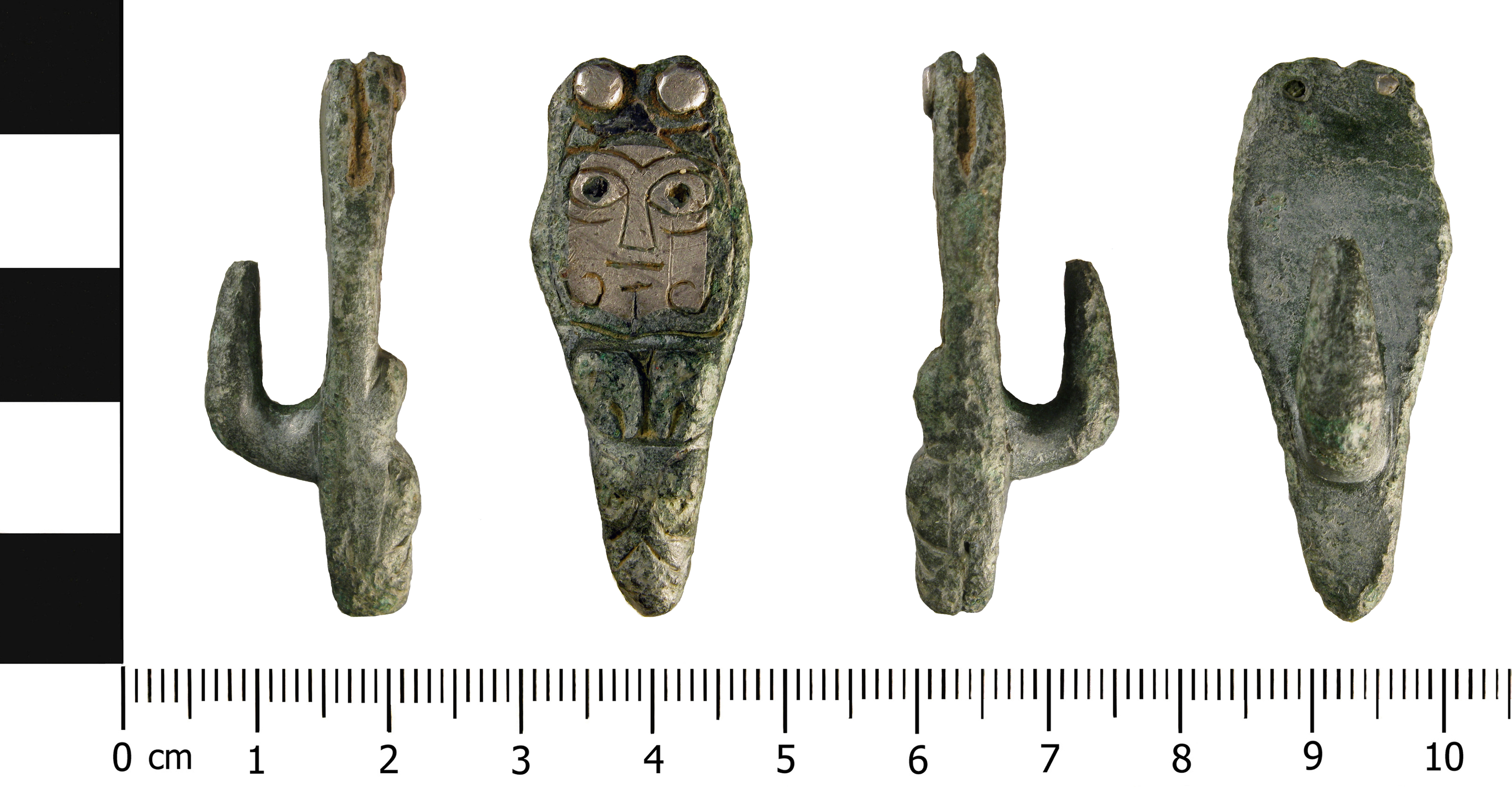 An Early medieval zoomorphic copper alloy strap end with a silver rivet, and a hook attachment on the reverse.