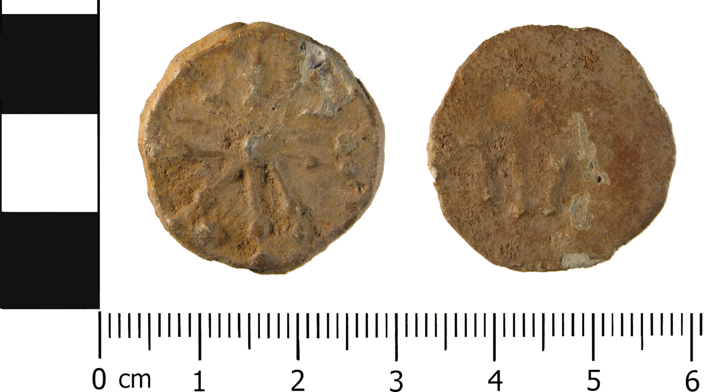WMID-F94A6C, a bifaced lead token.