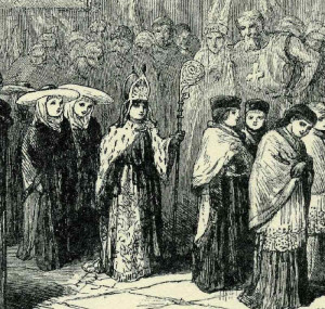 19th century depiction of a Boy Bishop attended by his canons. Unknown Author [Public domain], via Wikimedia Commons.