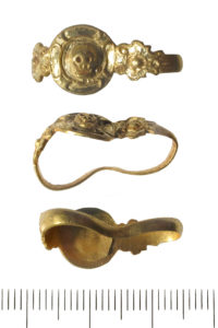 Gold ring with skull image