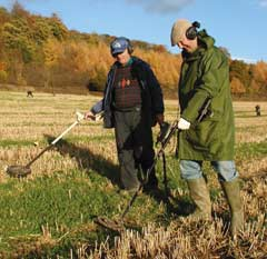 A pair of detectorists working a field