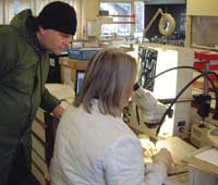 A detectorist being shown lab techniques for conservation