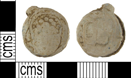 SUSS-7C80BB: A worn lead-alloy two disc cloth seal of probable Post Medieval date (c. AD 1600-1700).
