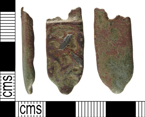 A resized image of An incomplete, early medieval, copper alloy, strap end, with silver foil, AD.750-1000.