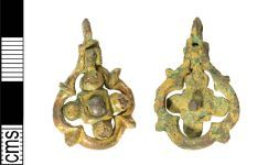 A resized image of Medieval gilt copper alloy harness pendant