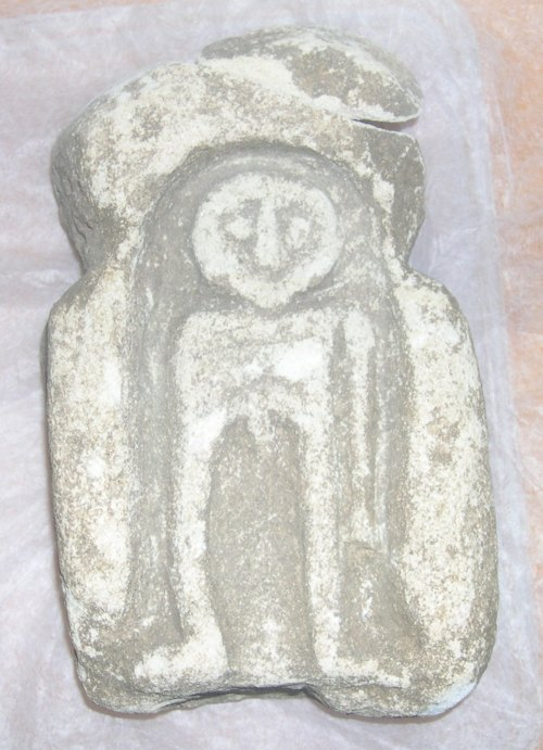 LIN-6F31A1: Limestone figurative carving, probably an altar piece depicting a naked man