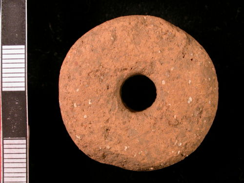 CORN-C91C45: Romano-British gabbroic ware spindle whorl