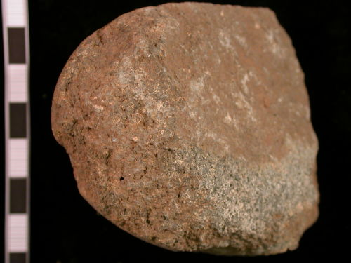 CORN-B64A85: Iron Age rotary quern fragment (section)