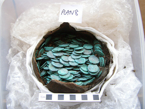 ESS-F89194: Roman coin hoard found in a pottery vessel during an archaeological investigation. Image courtesy of Colchester Archaeological Trust