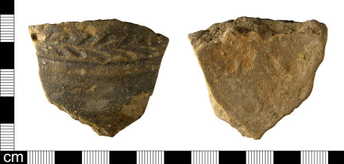 ESS-5076C4: A fragment of a Roman London-Essex stamped ware vessel, dating to the 2nd century AD.