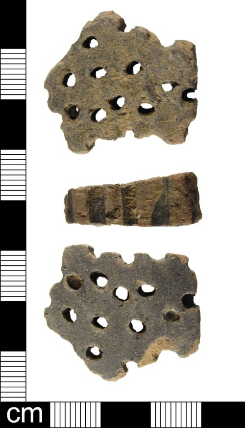 A resized image of A fragment of a late Iron Age grog-tempered spouted strainer bowl, dating 50 BC - AD 43.