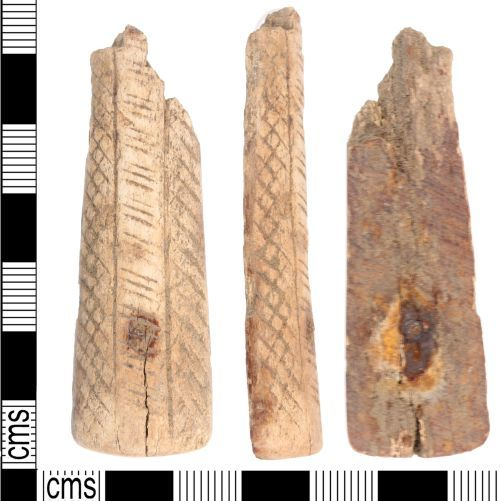 KENT-66BBC9: A incomplete Post Medieval bone knife handle with geometric decoration.