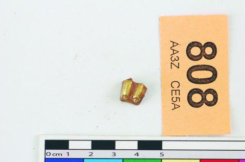 STAFFS-E5A814: A gold sword pommel cap
