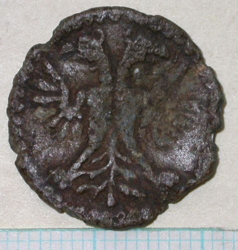 A resized image of 16th century lead token, obverse