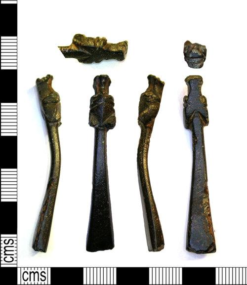 LEIC-A23F6E: Medieval copper alloy strap end, 1300-1400