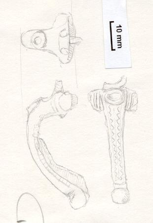 NLM654: Bow brooch
