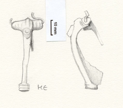 NLM803: Bow brooch