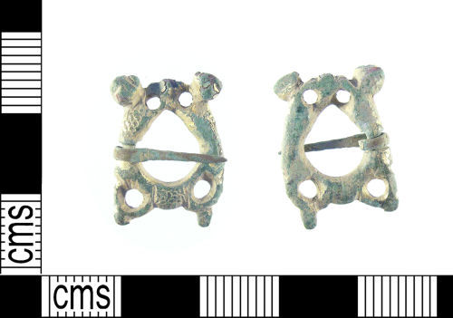 LON-336E11: A medieval gilt copper alloy zoomorphic annular brooch dating to the 13th century.