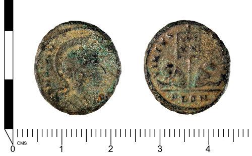 SWYOR-C9633D: Roman coin; nummus of Constantine I or II, VIRTVS EXERCIT two captives under a standard