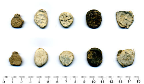 HESH-50A7A1: Five lead or lead alloy irregular circular tokens of medieval or post medieval date (1400-1700).