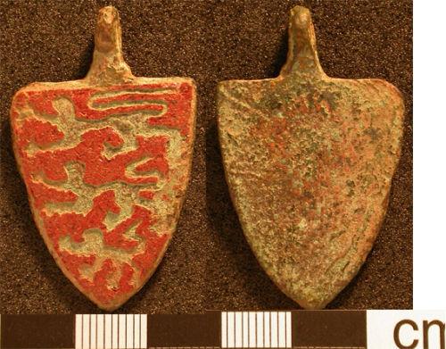 HESH-CD7B74: Heraldic harness pendant of probable 14th-century date.