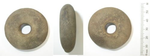 DENO-2FF205: Neolithic disc-shaped stone mace head.