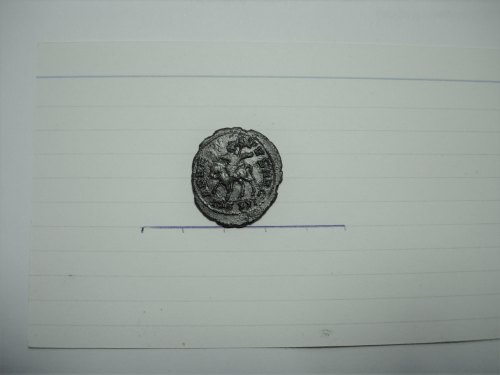 A resized image of Roman coin: radiate of Carausius ADVENTVS AVG MCXXI reverse