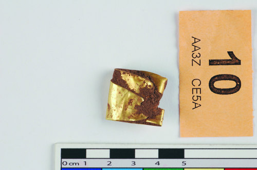 STAFFS-9554C2: A folded gold sword hilt plate