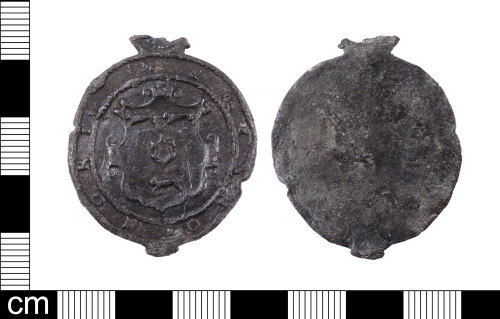LON-04F07A: A Post Medieval lead alloy cloth seal dating from AD 1600-1620.