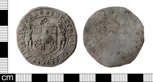 LON-A0853B: An incomplete Post Medieval lead alloy cloth seal of the Company of Royal Adventurers Trading to Africa dating AD 1660-1675.