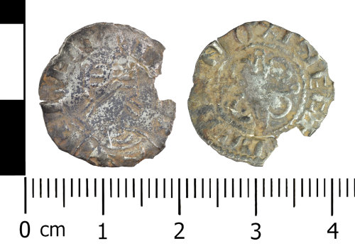 WREX-7C0FB5: Worn silver penny of Henry I dating c.1111AD, minted in Oxford.