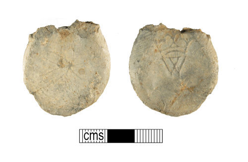 WMID-8F9A75: Medieval lead pilgrim's ampulla